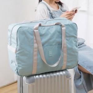 可折叠旅行包行李包袋女拉杆包手提轻便健身包短途旅游包男大容量(淘宝侵权)